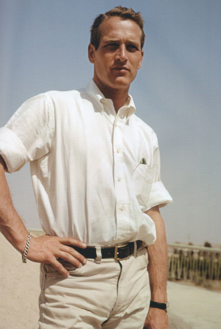 Paul Newman is chic as he wears a tucked-in button-down shirt with smart slim-cut pants.