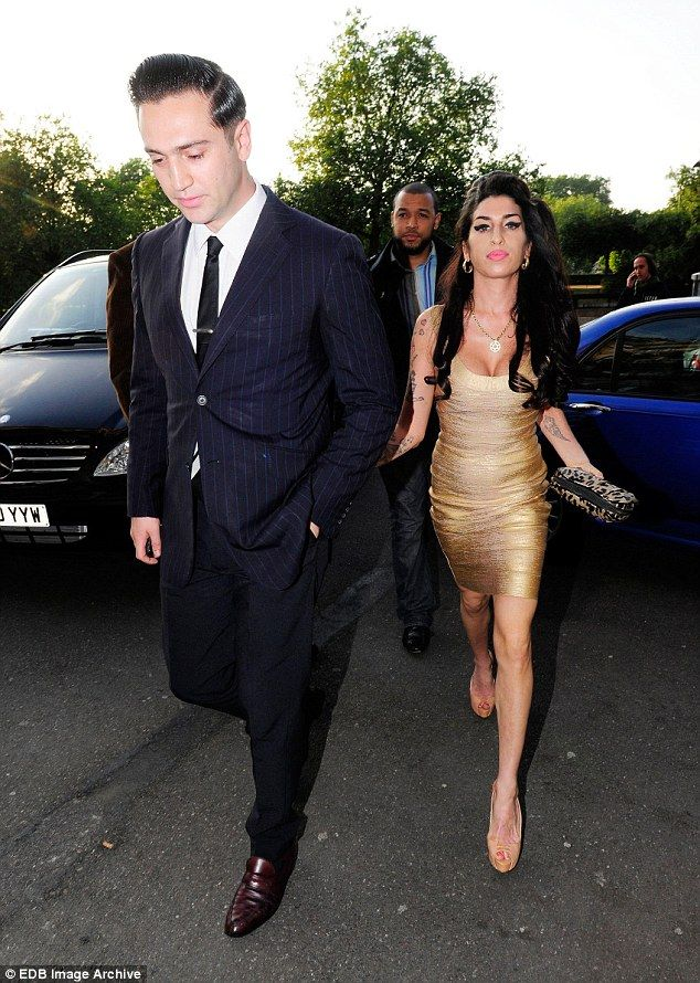 In happier times: Winehouse was in a relationship with film director Reg Traviss, who she ...