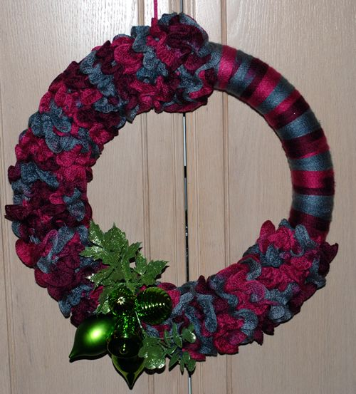 Ruffle yarn wreath... so much nicer than wearing it around your neck.