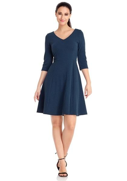 Keep your casual look fabulous and cool this fall with this navy geometric textured casual skater dress.