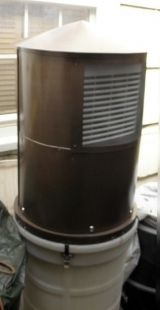 Atmospheric Water Generator - Homemade atmospheric water generator constructed from a condenser, an electric fan, a 5-gallon bucket, a 30-gallon drum, and filters. Capable of producing five gallons of water per day.