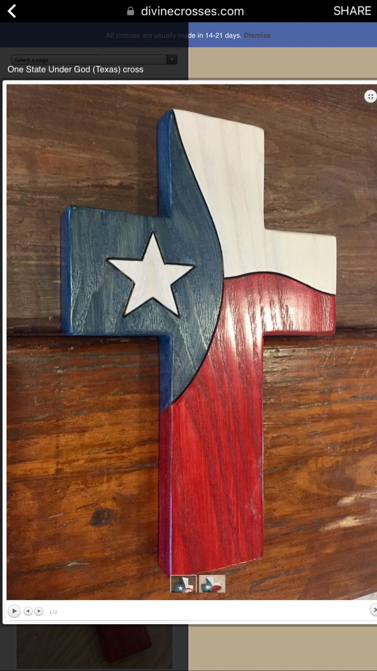 Wooden cross puzzle with American colors red white and blue.