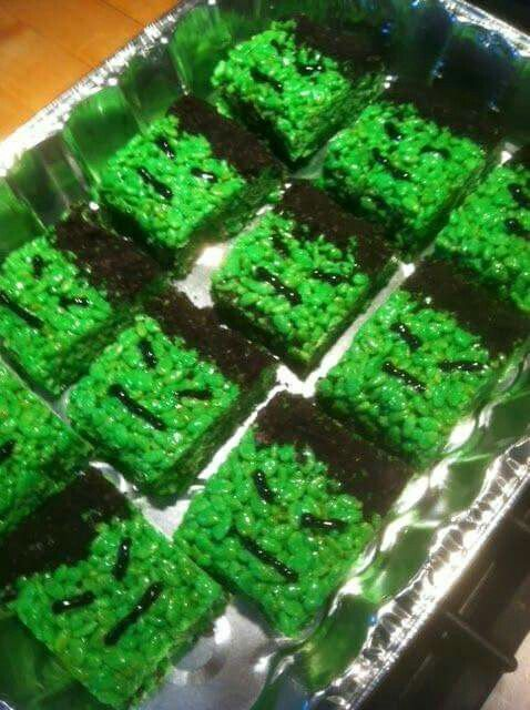 Make the usual rice crispy treat tinted green then use black gel from the baking isle for the mouth, eyes and hair.