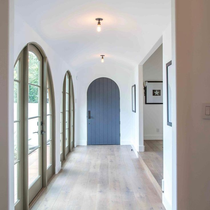 Simple serene entry with blue painted door