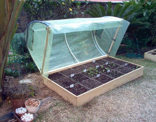 Square Foot Gardening Greenhouse | bottom frame is fastened to the raised bed with hinges to allow easy ...