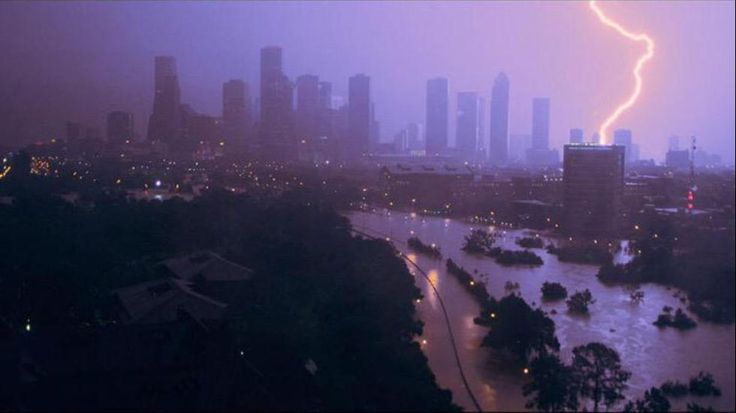 Houston Flood Nightmare -  Lightning hitting a building, illuminating the floodwaters that swamped the town