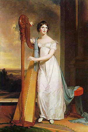 The empire waistline is the style where the bust is accentuated by a tie underneath the breasts, usually in another color, paired with a loose fitting or gathered skirt. Popularized by Josephine de Beauharnais.