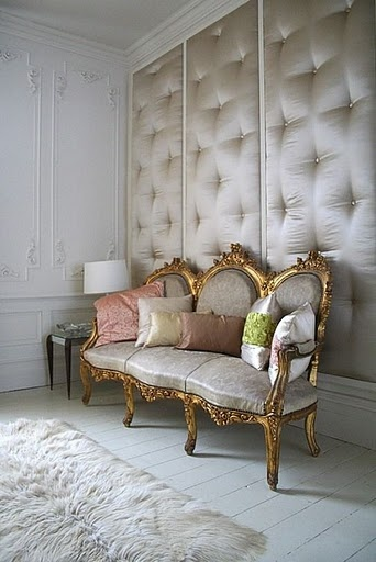 Upholstered walls are great for sound proofing a room. This is a bit opulent for my tastes, but I like the idea.