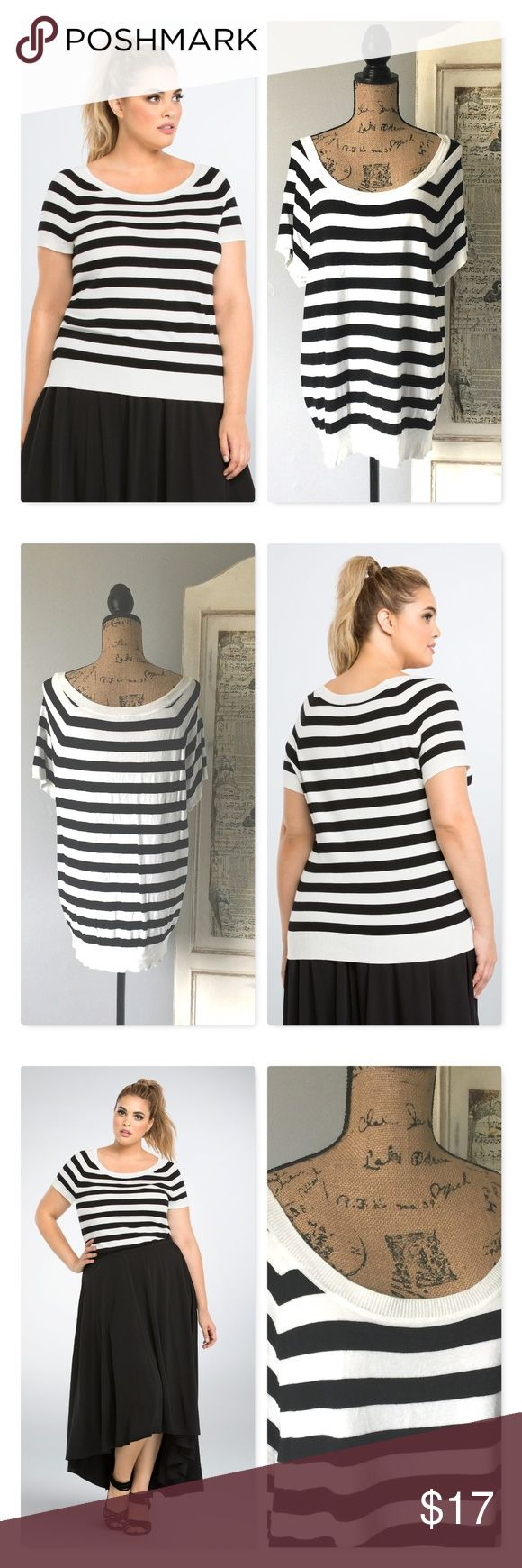 """Striped Pullover Top Lightweight Sweater Sz 2 A Parisian-inspired pullover top that's sure to charm, this short sleeved black and white striped knit style is très chic. A form fit with ribbed trim, a stretchy ribbed collar creates a deeper scoop neckline.  Model is 5'10"""" and wearing a Size 1.  I am selling a size 2.  Measures 28"""" in length.  Torrid Size Chart in last photo. Rayon/nylon. Wash cold, dry flat  #lisamariesvibe #torrid #plussize #curvy #striped #2x torrid Tops"""