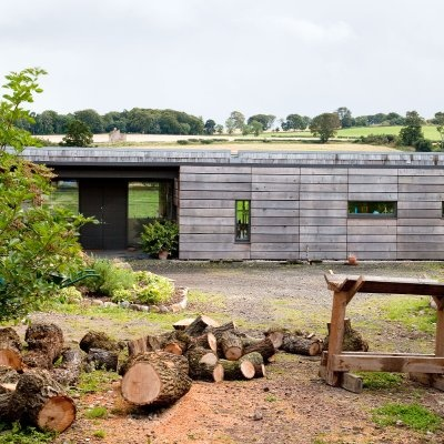 Chunky larch cladding (untreated). Grand Design, Midlothian.