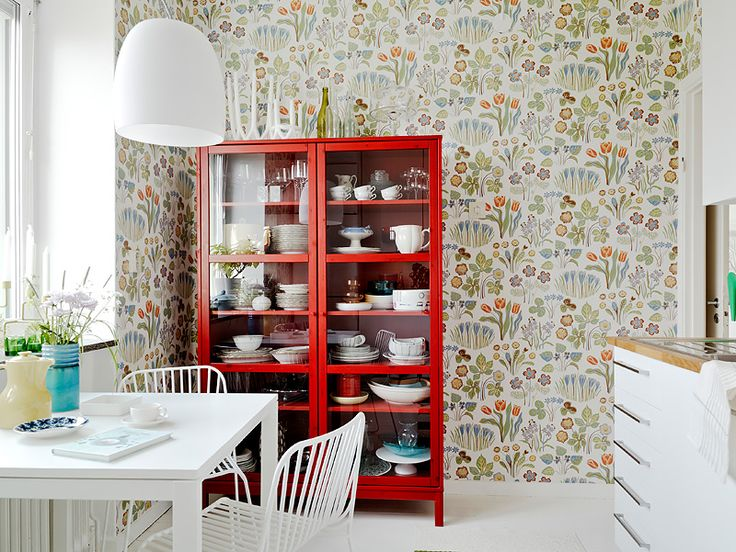 Colourful kitchen wallpaper. Love the red cabinet!