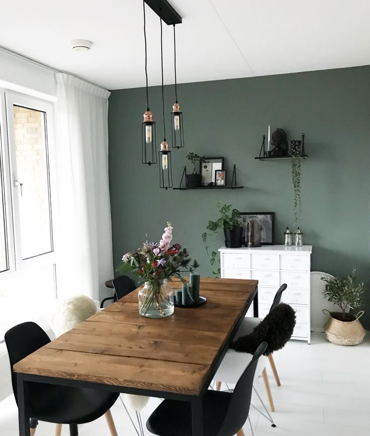 Love the accent wall, the rustic table, the black & white #diningroom #olivegreen