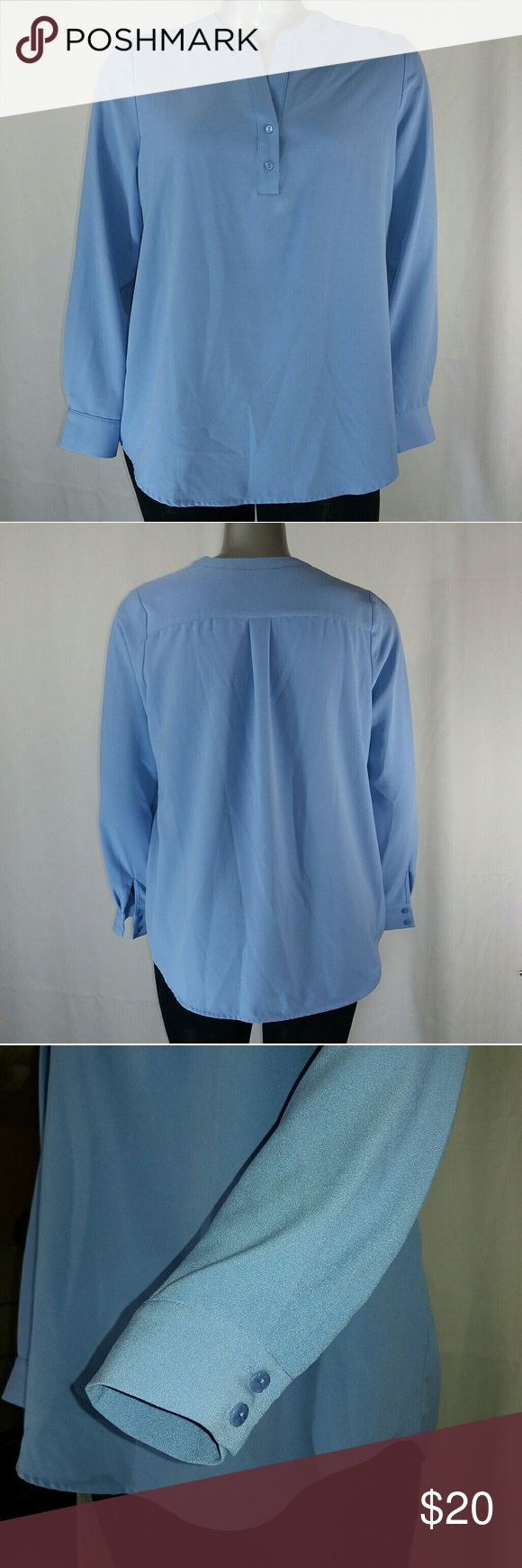 "Susan Graver Blue Long Sleeve V-Neck Blouse, 1 Medium weight, sky blue, long-sleeve, partial button front, v-neck blouse.   Excellent condition. Nice piece for work!   92% polyester, 8% spandex.   17"" sleeve, 29"" length, 48"" bust.   Size 14 by Susan Graver. Susan Graver Tops Blouses"