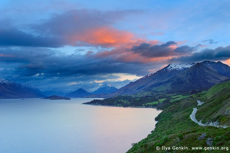 Looking up the Lake Wakatipu Towards Glenorchy at Sunrise, Queenstown, Lakes District, Otago, South Island, New Zealand. Stunning sunrise at Lake Wakatipu from Bennett's Bluff lookout, which is the most spectacular point on the entire road from Queenstown to Glenorchy. From here you can see for the first time right up past the head of Lake Wakatipu with the three islands in the lake. Tree island, a very small one on the left, then Pig Island and Pigeon Island.