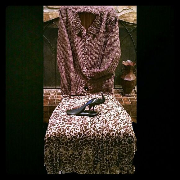 """RAFAEL Essential , 3 piece suit RAFAEL Essential 3 piece dress suit, beautiful boho style, a good addition for upcoming holiday sparkle, under shell glitters with sequins. (100% polyester), deep burgundy brown animal print skirt, 34"""" length, , puckered jacket. Skirts Maxi"""