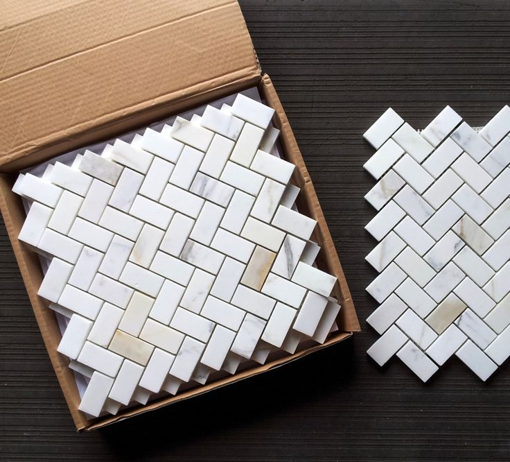 "Calacatta Gold Italian Marble 1x2"" Herringbone Mosaic Polished with New Venetian Gold granite countertops?"