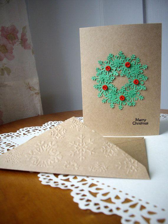 handmade snowflake wreath christmas card wreath by JDooreCreations  .... kraft base ... green pumched snowflakes ... coordinating envelope with snowflake embossed flap ...