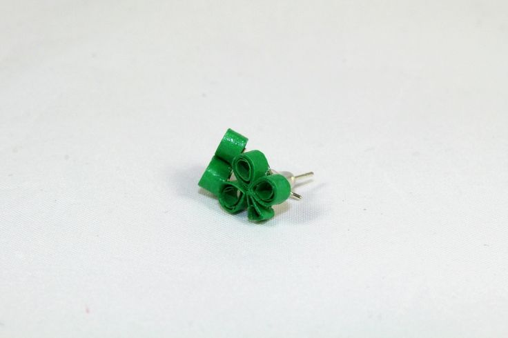 Tiny shamrock stud earrings handmade with quilling paper and attached to silver posts for your St Patricks Day jewelry outfit.