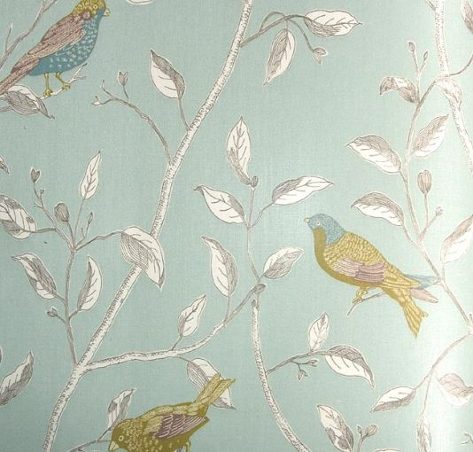 Finches Curtain Fabric Glazed cotton fabric printed with green birds on branches with a aqua background