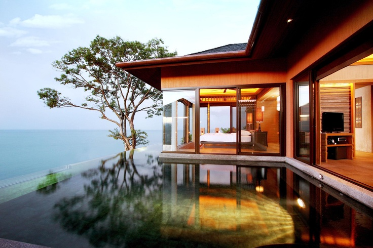 THAILAND - Sri Panwa Phuket. A stylish villa resort on Cape Panwa, Sri Panwa has natural beauty that rivals any in Phuket. Spread out over 40 acres of tropical forest high above the Andaman Sea, the minimalist villas have such luxe touches as infinity pools and private salas. But a full roster of activities — natural pampering in the top-notch spa, the three-tier dining pavilion, the rooftop bar and sizzling nightclub — keep the vibe hip and the guests busy.