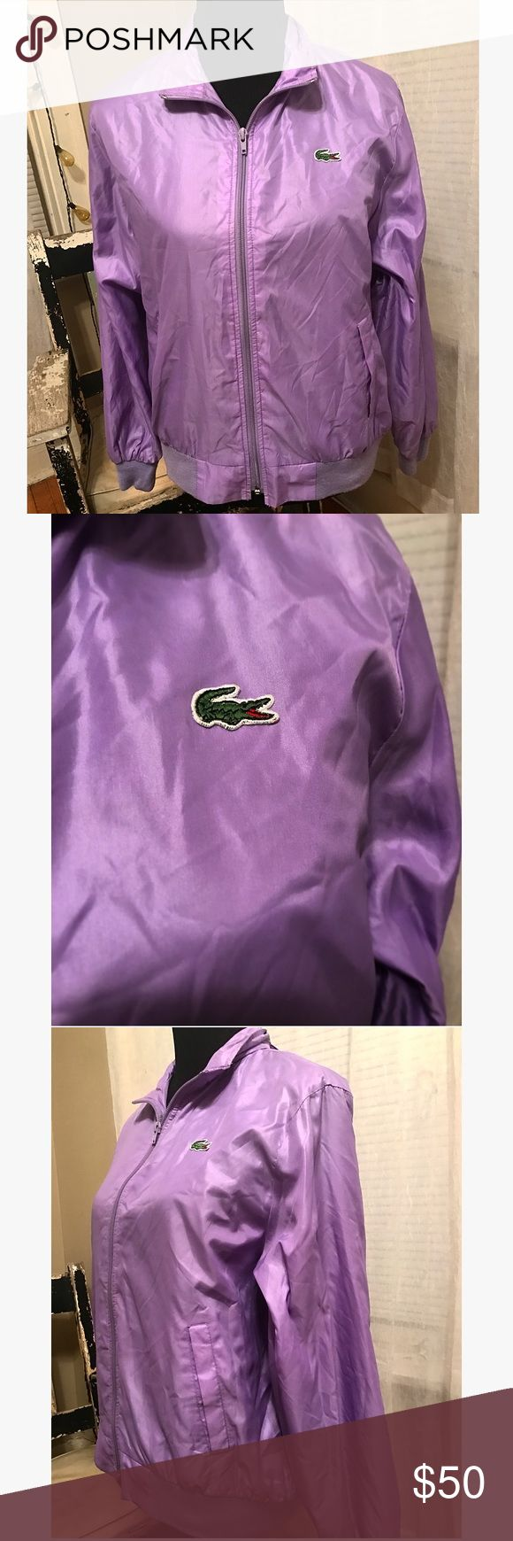 80s Izod Lacoste Nylon Windbreaker How awesome is this?! Gorgeous purple lavender color,women's medium, full zip, stow away hood in collar (can stuff hood in & zip up- see 4th& 5th pictures), 2 side slit pockets, 100% nylon. Hand wash luke warm/ drip dry. Literally in perfect condition/ looks as if it's never been worn Lacoste Jackets & Coats