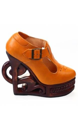 Shoe compensated out of orange leather and heel out of wooden Babies XVI