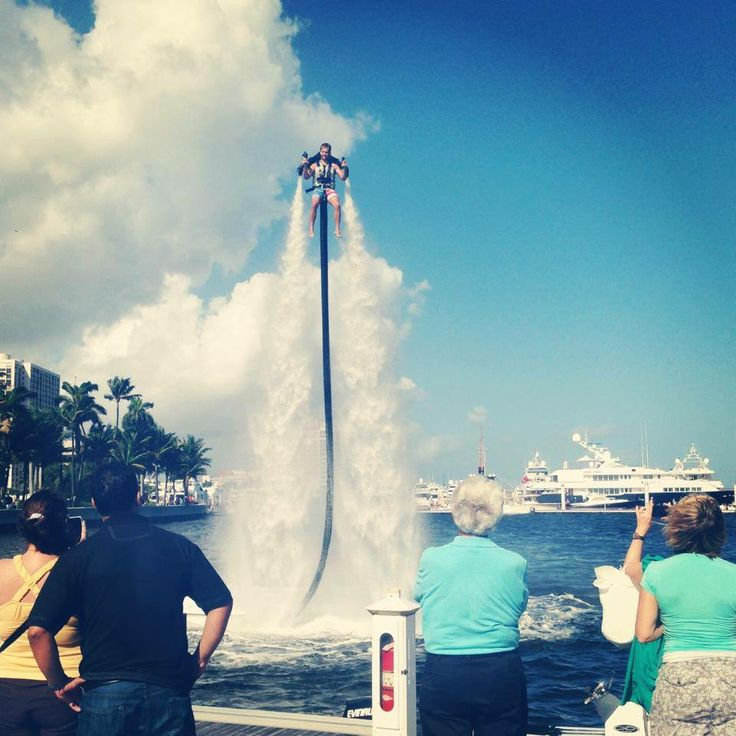 Extreme water jetpack pilot flying high in West Palm Beach, Florida.