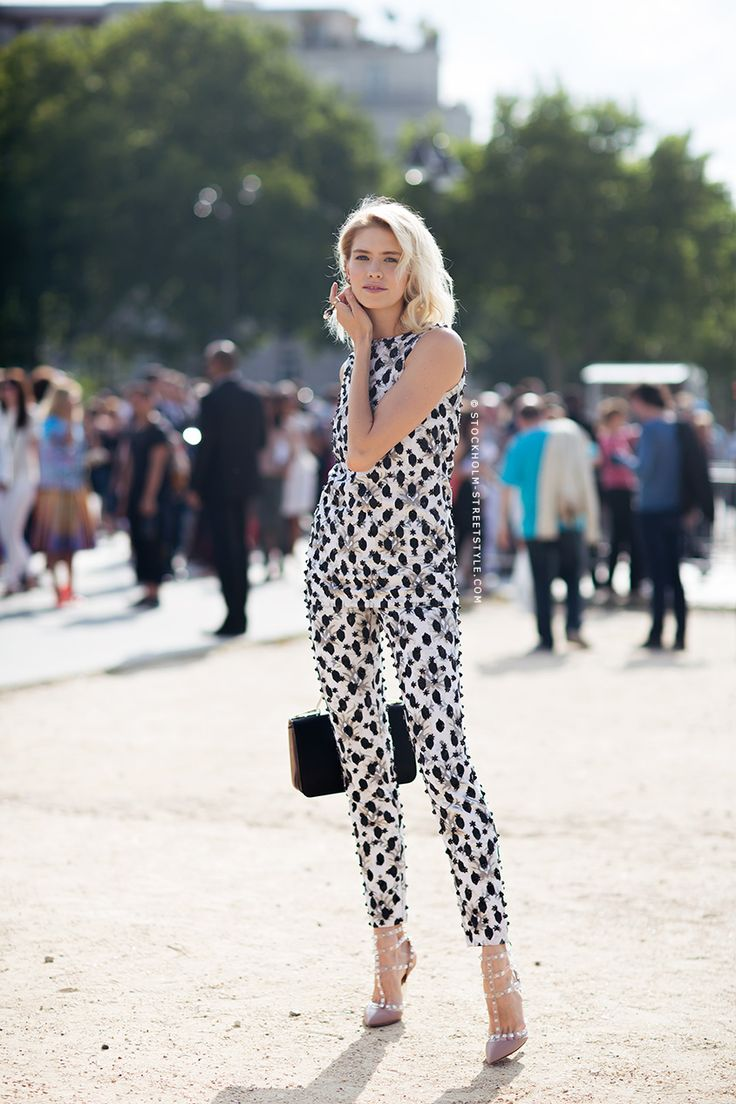 Elena Perminova in a sequined top and cigarette pants, with nude VALENTINO studded heels.