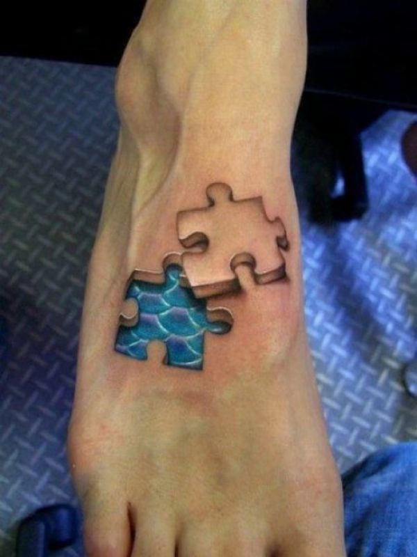 Optische Täuschung Puzzle Tattoo in 3D auf dem Fuß