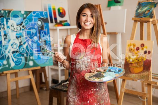 Beautiful female artist in her studio royalty-free stock photo