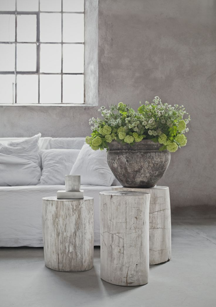 .white-washed stumps as end tables. Also, the fresh green with pale soft gray is very effective.