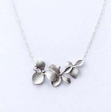 This beautiful sterling silver necklace with white gold plated orchids is stunning on!    Total length is 16″    Available in gold.    Matching earrings and bracelet available. $59