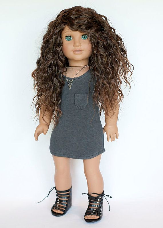 This listing is for one dress made to fit the modern American Girl dolls. It may fit other 18 inch dolls with similar body sizes. This adorable dress is made from a dark grey, jersey knit fabric. It has an uneven hem line, a tiny working pocket, and a velcro closure at the top back. All inside seams and edges are finished with a serger for a professional look. Dress fabric was pre-washed and sewn in my smoke-free home using a Liberty Jane pattern. Doll, jewelry, and shoes, not included…