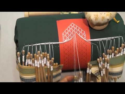 Bobbin lace pillow - roses ground. Interesting arrangement of bobbins not in use.