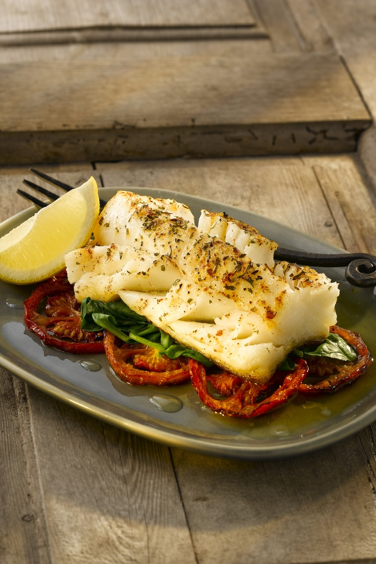 Lemon and Chilli Baked Fish with Roasted Tomatoes and Wilted Spinach. Recipe here: http://celebrityslim.com.au/recipes/seafood/lemon-and-chilli-baked-fish-with-roasted-tomatoes-and-wilted-spinach