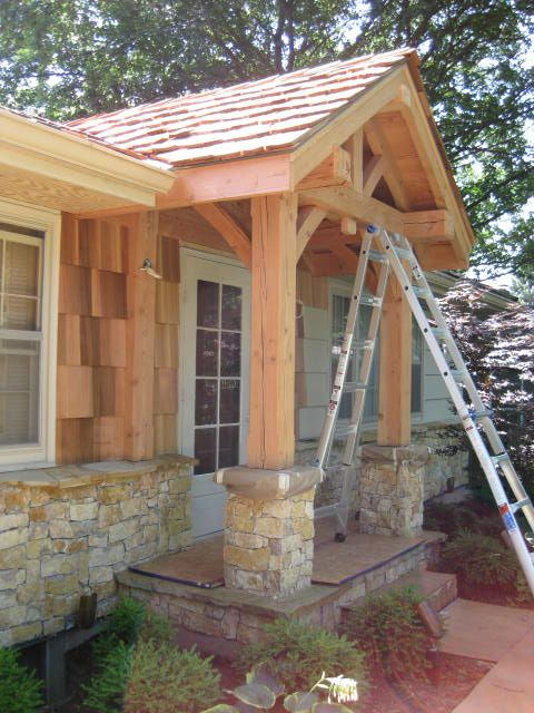 Timber frame entry example rhino builders out and for Timber frame porch designs
