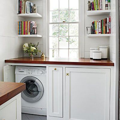 Hidden laundry in cabinetry.  Middle space to hide laundry needs with counter space for folding.