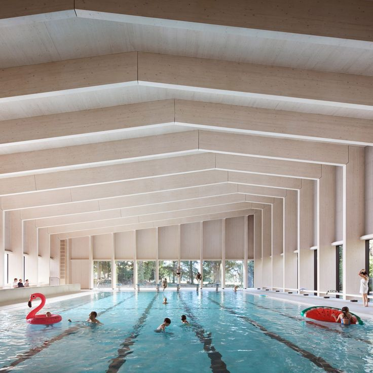 Architecture firm Hawkins\Brownused two types of engineered timber to build this swimming facility at a school in Surrey, England