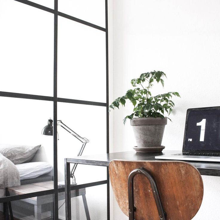 Scandinavian styled bedroom and home office separated by a windowwall in glass and steel. Love it!