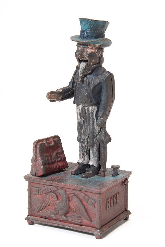 Vintage Uncle Sam Cast iron Mechanical Piggy Bank Coin Collector Americana Memorabilia by FineSelects on Etsy https://www.etsy.com/listing/186221883/vintage-uncle-sam-cast-iron-mechanical