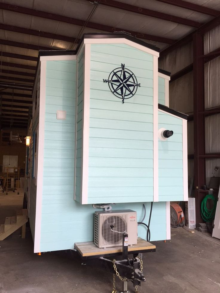 A beach-style tiny house on wheels from Cornerstone Tiny Homes.