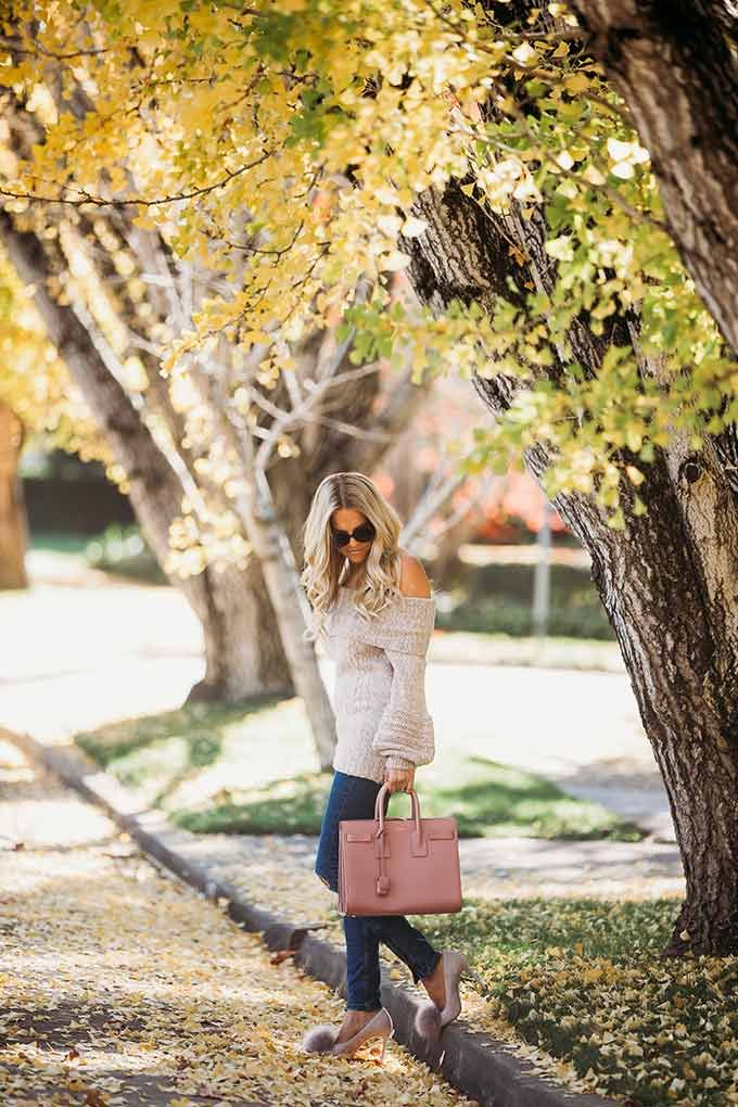Fall outfit idea - a cozy off the shoulder sweater and pom pom pumps makes for such a pretty feminine fall outfit! Click through to see more of this look.