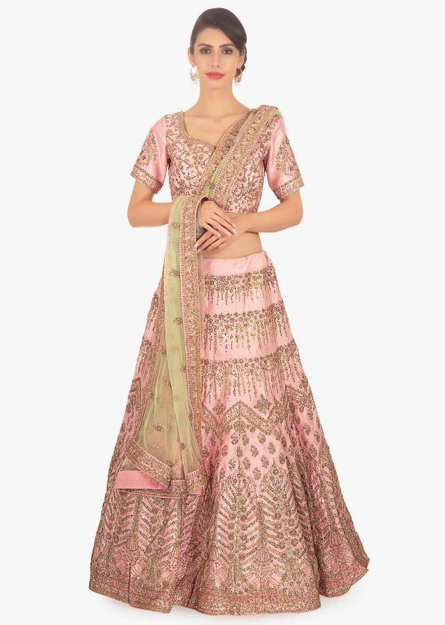 55de51b19d7c39 Pink raw silk embellished lehenga set paired with herbal green net dupatta  only on Kalki