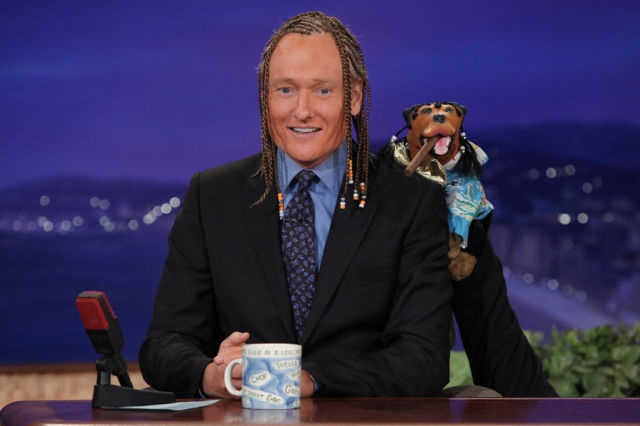 a braided and tanned triumph perches on conan's shoulder | conan o