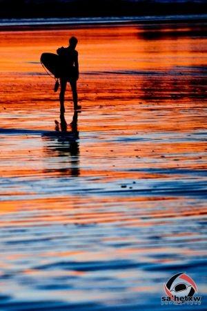 Surfer at Sunset on Mackenzie Beach, Tofino BC