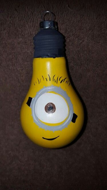 Minion hand painted lightbulb ornament.