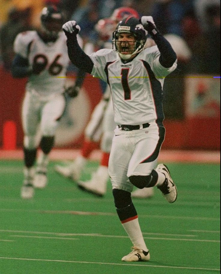 . Denver Broncos kicker Jason Elam (1) runs down the field to celebrate his game-winning field goal against the Buffalo Bills Sunday, Oct. 26, 1997, at Rich Stadium in Orchard Park, N.Y.   Elam kicked a 33-yarder with 1:56 left in the extra period as the Broncos overcame a 20-point Buffalo rally and defeated the Bills 23-20.  (AP Photo/Wayne Scarberry)