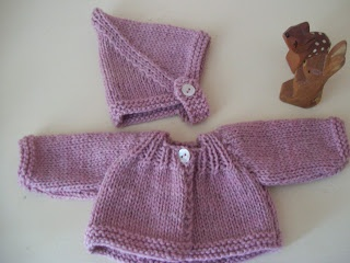 Knitted doll outfit by Poppenatelier Ineke Gray