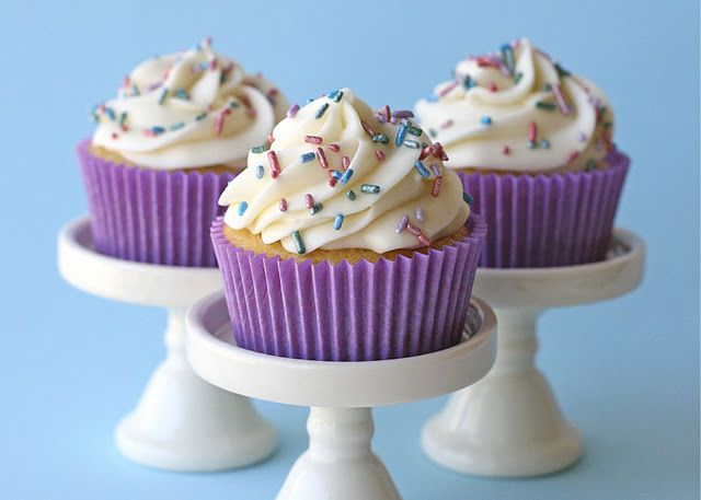 Perfect Vanilla Cupcakes...will be tryig these. And I want the cute stands.