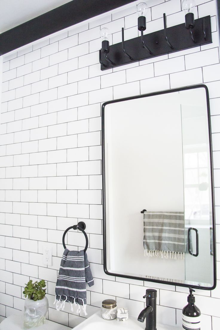 Black and white bathroom makeover, a bathroom with a mix of modern and vintage elements. Love this vintage recessed medicine cabinet!